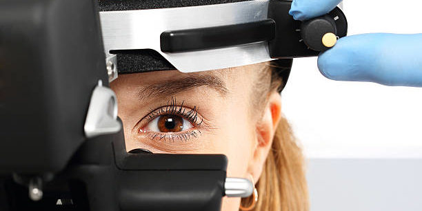 Ophthalmologist examines the eyes using a ophthalmic device